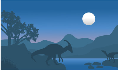 eoraptor and parasaurolophus in river scenery silhouette