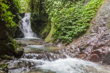 Small waterfall in Nambillo Cloud Forest Reserve near Mindo, Ecuador.