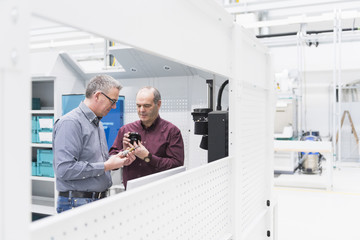 Manager and factory worker checking component