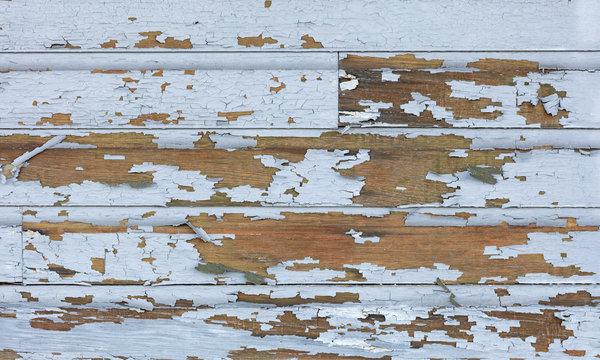 Old lead paint peeling off of wood sliding