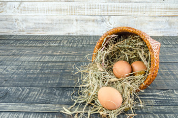 Fresh eggs in cup on wood vintage background