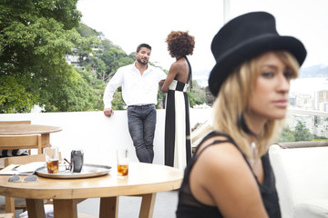 Couple on terrace, woman in foreground, Rio, Brazil