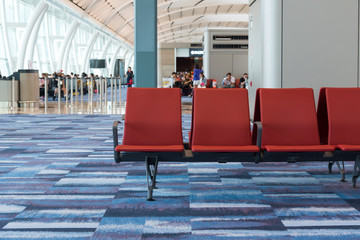 Row of chairs in waiting hall of airport