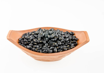 Black beans in a cup on a white background.