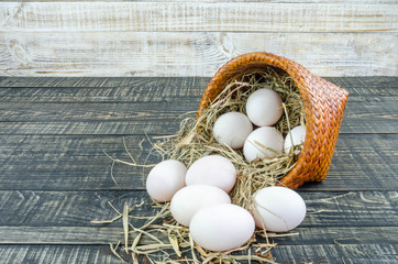 Fresh duck eggs on wooden background.