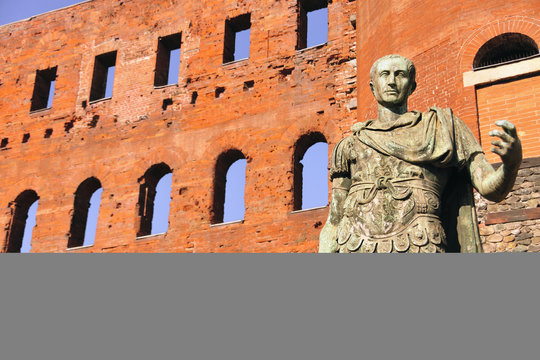 Ancient Roman bronze statue of Emperor Augustus, Porte Palatine city gate, Turin, Piedmont, Italy