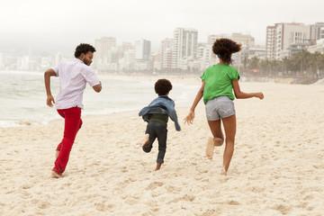 Couple and son enjoying beach, Rio de Janeiro, Brazil