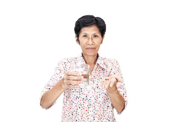 Asian senior woman taking a medicine