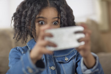 Close up of cute girl looking surprised for smartphone selfie