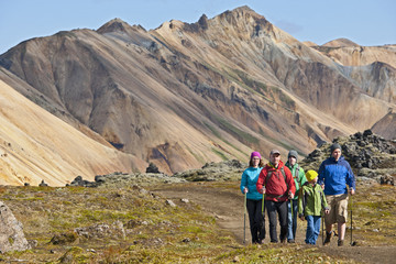 Mature couple and three sons hiking at Landmannalaugar, Fjallabak, Iceland