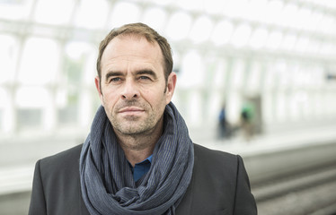 Mature man wearing scarf, portrait