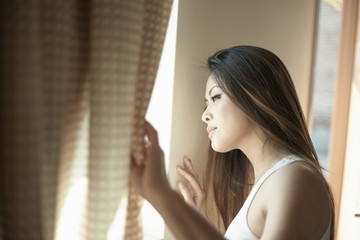 Attractive woman looking out of window