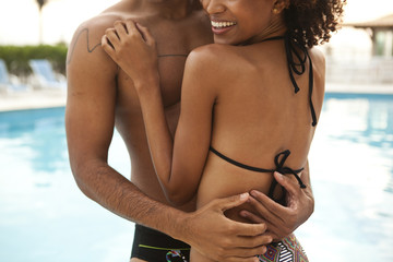 Cropped shot of couple hugging at hotel poolside, Rio De Janeiro, Brazil
