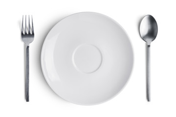 A white plate with silver fork and spoon