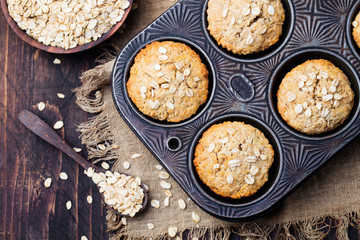 Healthy vegan oat muffins, apple and banana cakes in vintage pan Top view