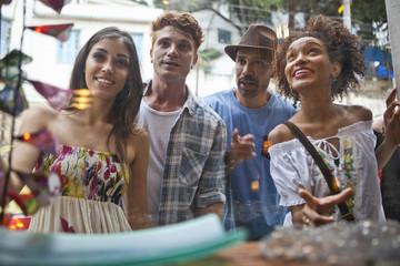 Group of friends looking in shop window