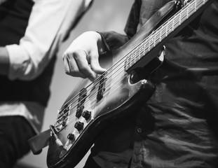 Bass guitar player, closeup photo