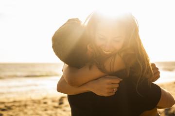 Couple having fun on beach, Malibu, California, USA