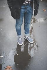 Woman on wet street