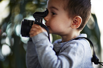 Boy taking photograph with camera