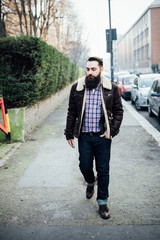 Young bearded man on pavement