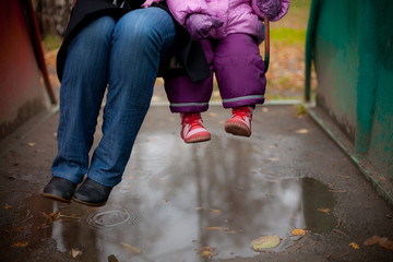 adult and child swinging on a swing