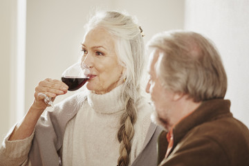 Senior woman drinking red wine