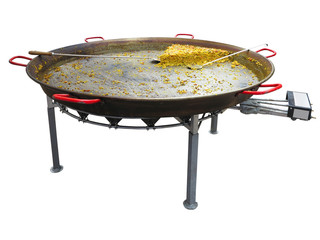Paella on giant frying pan done at the carnival isolated