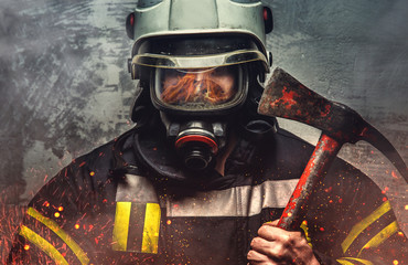Firefighter in oxygen mask.