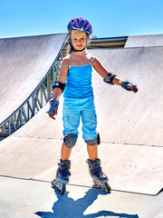 Girl riding on roller skates in skatepark. Roller skates is extreme sport.