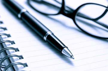 Pen, Glasses, and Lined Notebook Paper