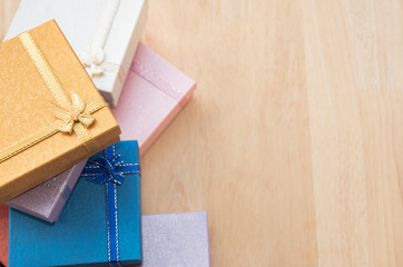 colorful gift box on wooden background.