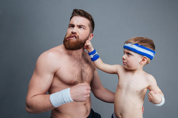 Funny bearded dad and his son fighting