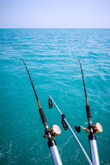 Two Fishing Poles Over Water