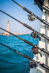 Four Fishing Poles on a Charter Boat