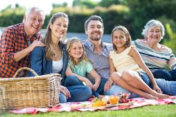 Happy multi-generation family sitting on blanket