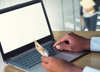 business man online shopping with credit card and laptop computer