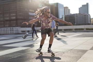 Young man balancing on skateboard