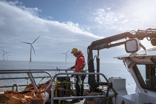 Engineer on deck of service boat at offshore windfarm