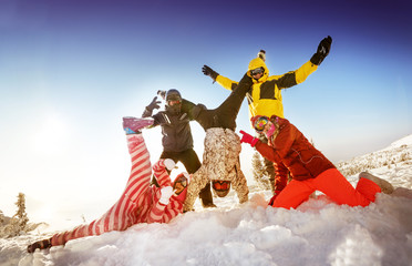 Group of happy friends skiers and snowboarders having fun on the slope of a mountain. Sheregesh resort, Siberia, Russia