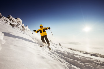 Skier rides on the slope. Sheregesh resort, Siberia, Russia. Space for text
