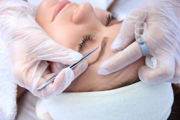 woman eyebrow correction