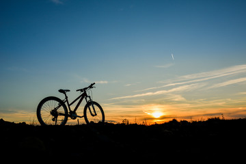 Bike at sunset on a field