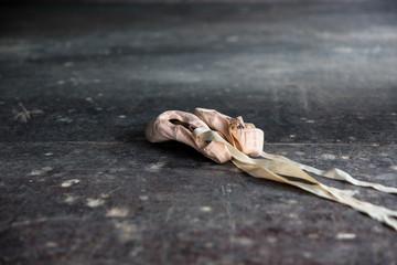 Ballet shoes on floor