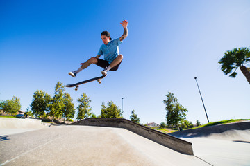 Young man skateboarding in park, Eastvale, California, USA