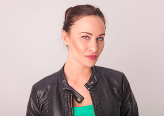 fresh young woman in leather jacket