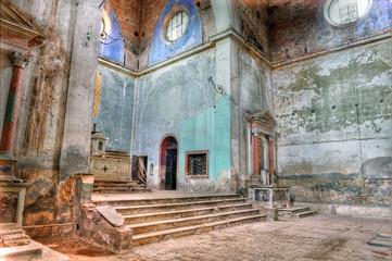Derelict, abandoned, Italian church interior.