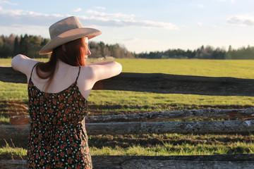 girl in a cowboy hat in a field