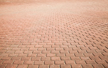 Modern red cobblestone pavement, background Wall mural