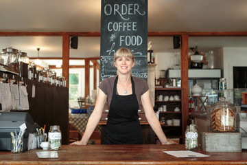 Portrait of female shop assistant in country store cafe
